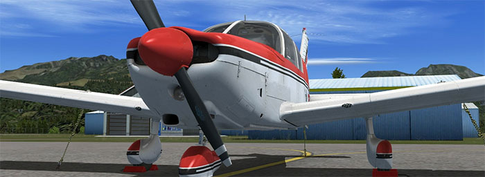 Red Cherokee with propeller showing and nose