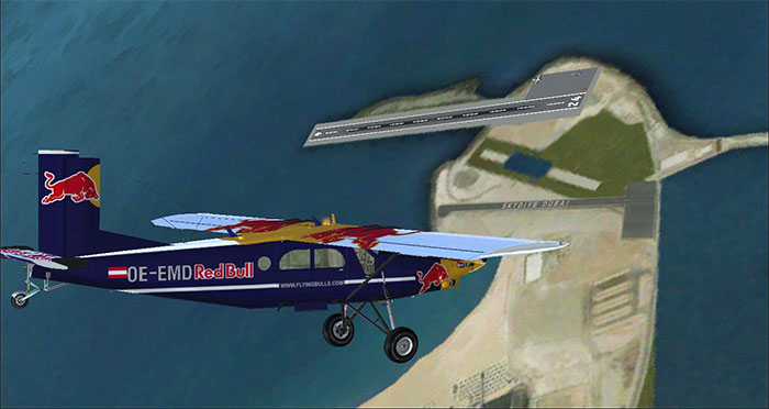 Skydive Dubai showing Red Bull aircraft and runway.