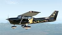 Skyhawk midflight over land.