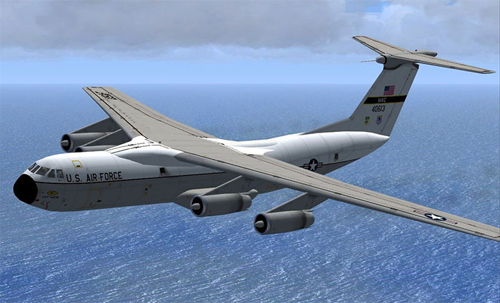 C-141 Starlifter flying over ocean.
