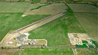 Aerial view of the airport and runway.