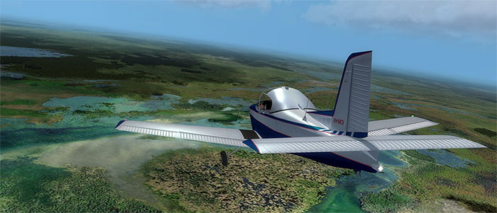 The Victa Airtourer flying over swamp land.
