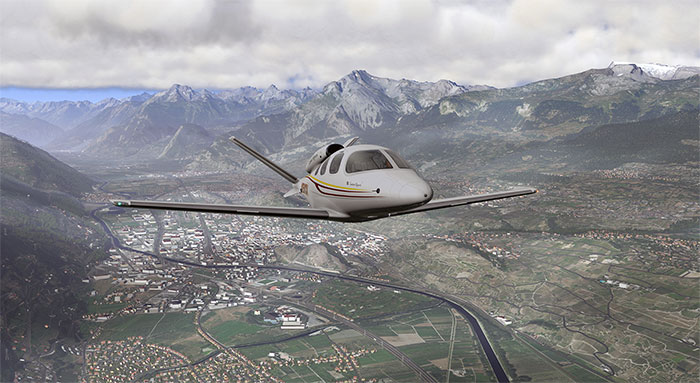 Cirrus Vision flying over mountainous region.