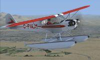 A2A J-3 Cub in flight.