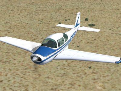 Blue Aero Commander-Meyers 200D in flight.