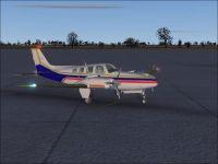 Beechcraft Baron 58 in flight.