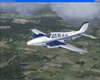 Beechcraft Baron G58 N453TB in flight.