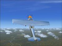Cessna 172 Bare Metal Baby in flight.