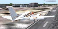 Cessna 404 Titan taking off.