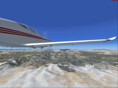 Front side view Glasair III in flight.