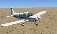Grumman American AA1-5B Tiger in flight.
