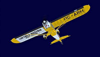 """Luftbild Austria"" Piper Super Cub in flight."