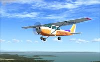 Multicolor Cessna C172 in flight.