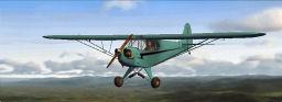 Piper J-3 Cub in flight.