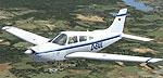 Piper Arrow III in flight.