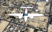 Double engine private aircraft flying over West Texas.