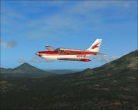 Red Saratoga II TC in flight.
