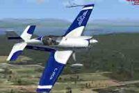 Saguenay Express Extra 300 in flight.