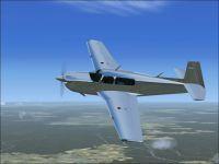 Silver Mooney in flight.