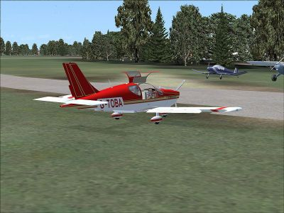 Socata TB10 Tobago on the ground with doors open.