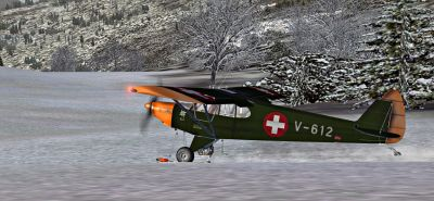 Swiss Air Force Piper Super Cub landing on snow.
