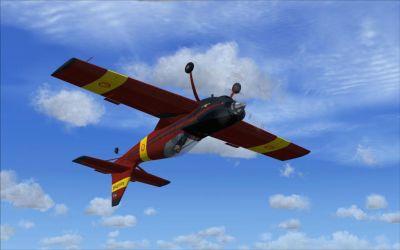 Zlin Z-50Ls flying upside down.