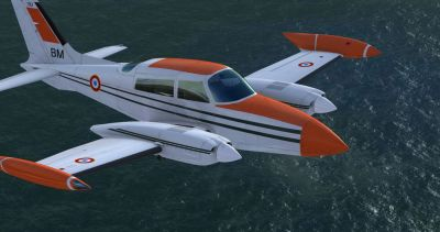 CEV Cessna C310R flying over water.