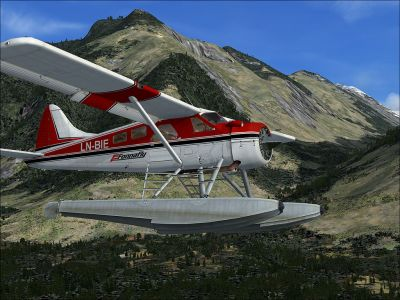 DHC-2 Beaver LN-BIE flying by mountains.