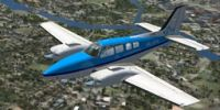 KLM Flight School Beechcraft Baron 58 in flight.