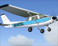White and blue Cessna 150L in flight.