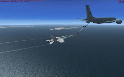 US Navy Boeing KC-135T Drogue Tanker refuelling a jet.