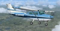 Blue And White Cessna 172 in flight.