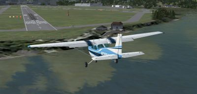 Blue And White Cessna 172 approaching runway for landing.