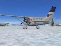 Blue Cessna 206.