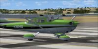 Green Cessna Skyhawk 172 on runway.