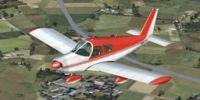 Red Piper Cherokee in flight.