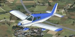 Blue Piper Cherokee in flight.
