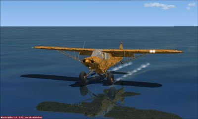 Piper Super Cub flying low over water.