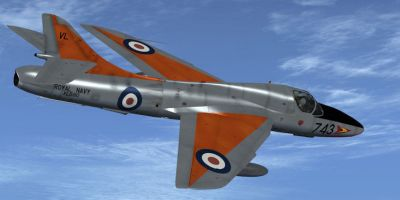 Silver-Dayglo Royal Navy Hunter in flight.