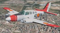 Spain Air Force Beech Baron 58 in flight.