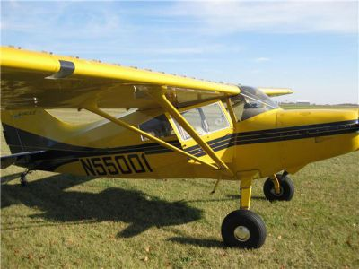 Photograph of a yellow and blue Maule 260C.