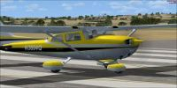 Yellow Cessna Skyhawk 172 on runway.