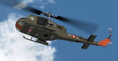 Austrian Air Force Bell UH-1C in flight.