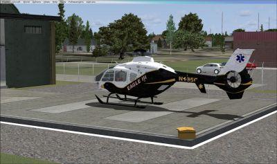 County Rescue EC-135 Eagle III on helipad.