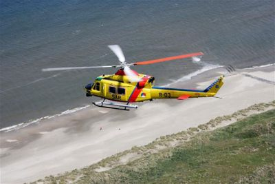 Photograph of Dutch Aviation Bell 412 EP in flight.
