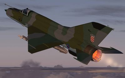 German Democratic Republic MiG-21 in flight with afterburner engaged.
