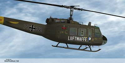 """""""HTG 64 Luftwaffe"""" Bell UH-1D in flight."""