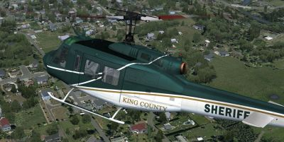 King County Sheriff's Office Bell UH-1H in flight.