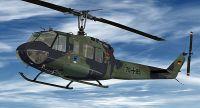 """""""LTG 61"""" Bell UH-1H in flight."""