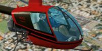 Red/Black Robinson R22 in flight.